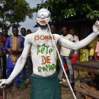 "A man painted with the phrase ""Happy Ramadan"" in French dances through the streets of Abidjan, Ivory Coast."