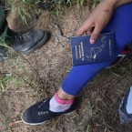 An El Salvadoran child is interviewed by a U.S. border patrol agent after crossing the Rio Grande from Mexico into the U.S. to seek asylum on Apr. 14, 2016 in Roma, Texas.