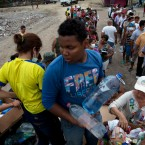 Volunteers deliver food and potable water to the people that lost their homes in the 7.8 magnitude earthquake that hit Ecuador's Pacific coast, in Canoa, Ecuador.