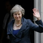 Britain's Home Secretary Theresa May waves towards the media as she arrives to attend a cabinet meeting at 10 Downing Street, in London, Tuesday, July 12, 2016. Theresa May will become Britain's new Prime Minister on Wednesday.