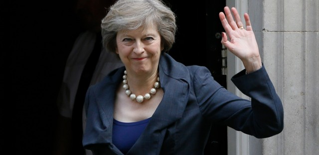 Britain's Home Secretary Theresa May waves towards the media as she arrives to attend a cabinet meeting in London. May became Britain's new Prime Minister on Wednesday.