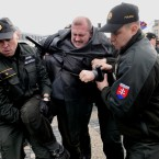 Slovakia1 (podcast) : Slovak police officers detain Marian Kotleba, center, leader of officially banned association Slovak Togetherness, during a rally in Bratislava, Saturday, March 14, 2009. Some 300 people gathered in downtown Bratislava to mark the 70th anniversary of the independent Nazi-sponsored Slovak State. (AP Photo/CTK, Jan Koller)