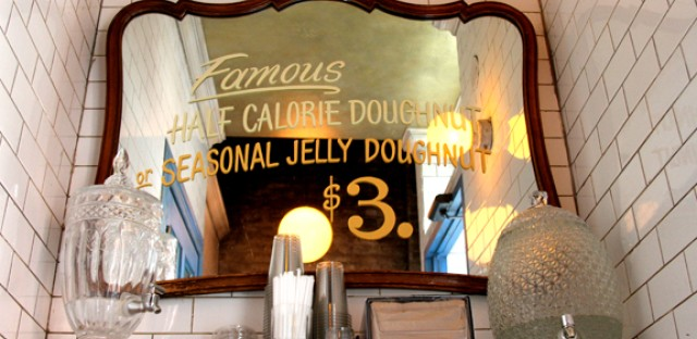 The aesthetics of Doughnut Vault in Chicago's Loop are telling of the city's doughnut history. While old-school doughnut shops still exist, they do so among the growing number of pricier and more artisanal shops.