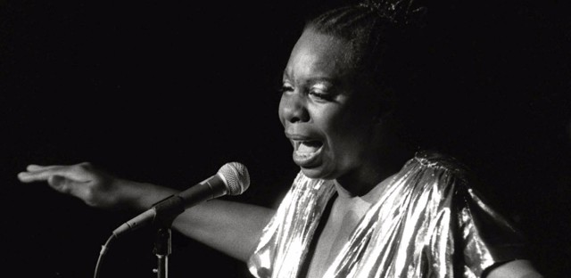 "In this June 27, 1985 file photo, singer Nina Simone perfroms at Avery Fisher Hall.  Producers of the forthcoming biopic ""Nina"" have been criticized for casting an actress who needed extensive makeup and prosthetics to achieve Simone's dark skin and traditionally African features."