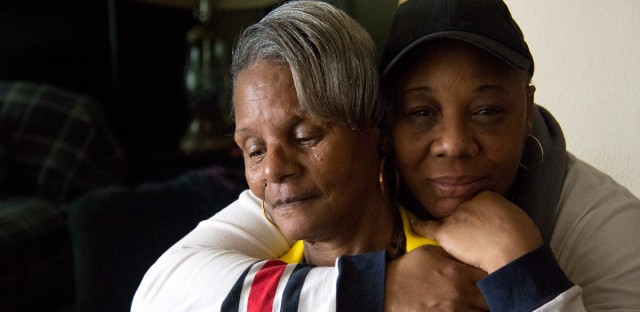 Seonia Owens, left, talks about her son, Robert Owens, who was 15 when he was fatally shot in 1998. Sharon Burgman-Owens, right, is Robert's older sister.