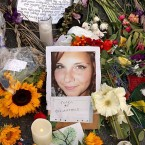 Flowers, candles and chalk-written messages surround a photograph of Heather Heyer on Wednesday, on the spot in Charlottesville, Va., where she was killed and 19 others injured by a car attack on Saturday.