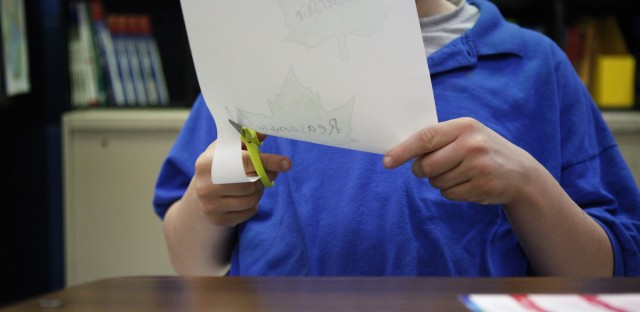A student cuts out leaves in Lisa Elder's Life Skills class.