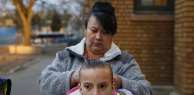 Cyndy Bulson fixes her granddaughter's hair before school starts at Stocking Elementary School.