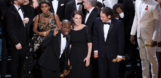 "Barry Jenkins, foreground left, and the cast accept the award for best picture for ""Moonlight"" at the Oscars on Sunday at the Dolby Theatre in Los Angeles."