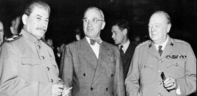 President Harry Truman, center, talks with Soviet leader Josef Stalin,left, and British Prime Minister Winston Churchill, at the Potsdam Conference near Berlin, on July 17,1945. Historians declare the conference was the start of the Cold War, the division of Germany and Europe into opposing camps. Hiroshima became an A-bomb target while the conference was under way. The nuclear arms race probably began forming in the minds of Soviet leaders while they were there.