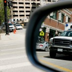 A Chicago Police vehicle is reflected in a mirror as pedestrians cross a street in downtown Chicago on Thursday, May 3, 2007. Chicago Mayor Richard Daley, smarting from high-profile allegations of rogue police beating citizens they're supposed to protect, said on Thursday that the agency that reviews officer-misconduct allegations should report directly to him instead of the Chicago police superintendent, hoping to quash the perception that rogue officers aren't held accountable.