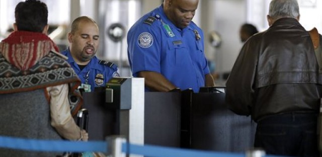 In this Nov. 25, 2015 file photo, Transportation Security Administration agents check travelers identifications at a security check point area in Terminal 3 at O'Hare International Airport in Chicago. Fliers who don't have the latest driver's licenses will have a two-year reprieve before their IDs are rejected at airport security checkpoints. Many travelers had been worried that the Transportation Security Administration would penalize them because of a federal law requiring the more-stringent IDs at the start of this year.