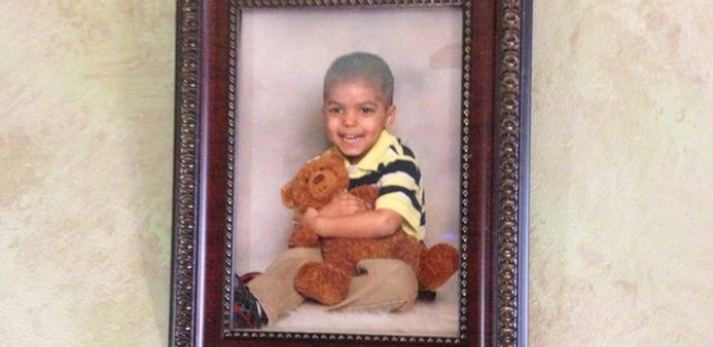 A picture of Dasani Young that hangs in the house of his one-time foster mother. The mom says both the parents and Indiana's Department of Child Services share blame for what happened after they left her care.