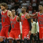 Chicago Bulls center Robin Lopez (8), guard Rajon Rondo (9), guard Dwyane Wade (3) and forward Jimmy Butler (21) walk on the court during the second half of an NBA basketball game against the Miami Heat, Thursday, Nov. 10, 2016, in Miami. The Bulls defeated the Heat 98-95.