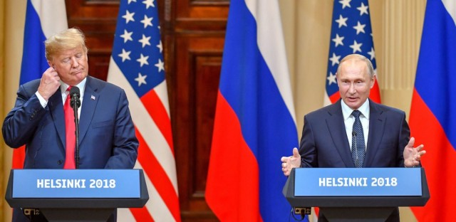 President Donald Trump and Russia's President Vladimir Putin hold a joint press conference after a meeting at the Presidential Palace in Helsinki, on Monday. Yuri Kadobnov/AFP/Getty Images