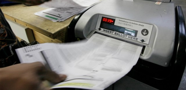 Cook County Board of Elections workers count paper ballots in Chicago from an Illinois primary election.