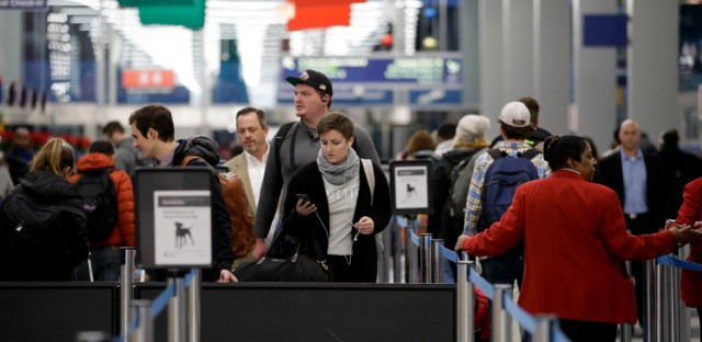 Thanksgiving holiday travelers line up at a security checkpoint area in Terminal 3 at O'Hare airport in Chicago, Tuesday, Nov. 21, 2017.