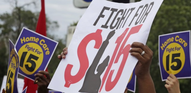 Protesters participate in a rally on Chicago's South Side on Sept. 14, 2014 as labor organizers campaign raise the minimum wage for employees to $15 an hour.