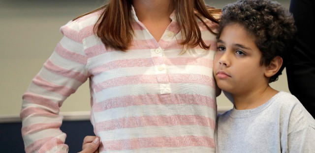Lidia Karine Souza holds her son Diogo De Olivera Filho at the Mayer Brown law firm in downtown Chicago shortly after they were reunited on June 28, 2018. The 9-year-old Diogo was separated from his mother at the U.S.-Mexico border in May. (AP Photo/Charles Rex Arbogast)