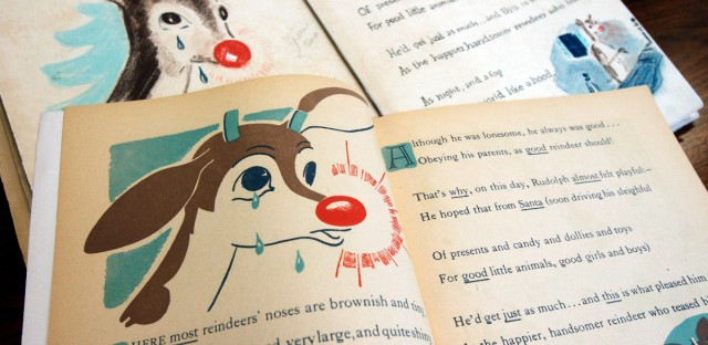 """A first edition of """"Rudolph, the Red-Nosed Reindeer"""", bottom, and an original layout, top, part of a special collection at Dartmouth College, are displayed on Tuesday, Dec. 20, 2011 in Hanover, N.H. The book is from the estate of Robert May, a Dartmouth graduate who wrote the famous story in 1939 as part of a Montgomery Ward marketing campaign."""