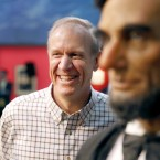 Gov. Bruce Rauner stands near a statue of Abraham Lincoln in Springfield on Jan. 11, 2015. Lincoln scholars said Rauner misattributed a quote to the 16th president during his State of the State speech this week.