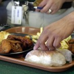 A tray of food is prepared at a Houston Pollo Campero on Jan. 9, 2003.