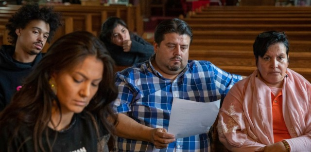 In this Wednesday, June 19, 2019 photo, attorney Roberto Lopez, center, and pastor Jacobita Cortes participate in an emergency meeting plan of action on how to defend and protect undocumented communities of deportation at Lincoln Methodist Church. With renewed pledges on mass deportations, immigrant rights activists have fine-tuned and ramped up one of their most basic organizing tools: The know-your-rights training.