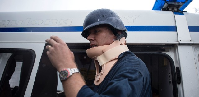 Australian journalist Adam Harvey wears a neck brace Thursday after being struck by a stray bullet in the Philippine city of Marawi.