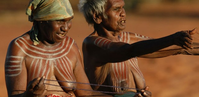 <p>Aboriginal women from the remote Central Australian community of Ampilatwatja performing at a public ceremony in 2010, to protest against the Northern Territory intervention.</p>