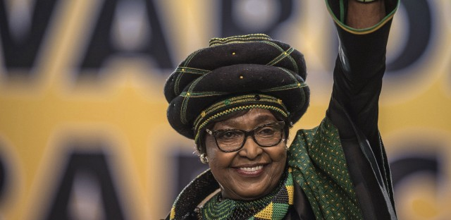 Winnie Madikizela-Mandela waves as she attends the 54th ANC National Conference in Johannesburg late last year.