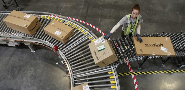 A worker sorts packages at an Amazon.com fulfillment center. In 2016, women earned 81.8 percent of what men earned on a weekly basis, according to the Bureau of Labor Statistics.