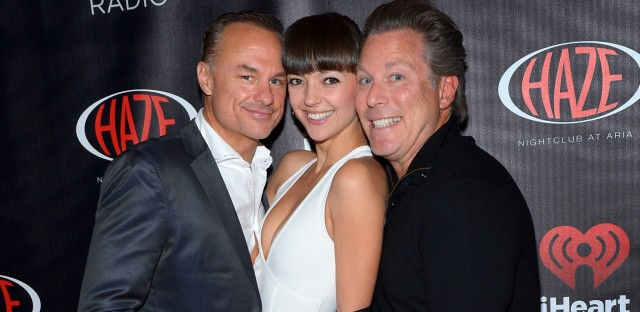 Ross Levinsohn (right), with his frequent business collaborator, James Heckman, at a 2014 iHeartRadio party at CES in Las Vegas. They are accompanied by Heckman's wife, Emilia.