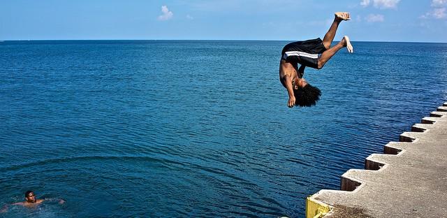 Boys jumping into Lake Michigan