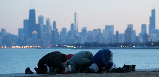 A Muslim family prays at Montrose beach in Chicago on Jan. 29, 2012.