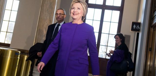 Former Secretary of State Hillary Clinton and John Podesta arrive for a portrait unveiling ceremony for retiring Senate Minority Leader Harry Reid, D-Nev., last week.