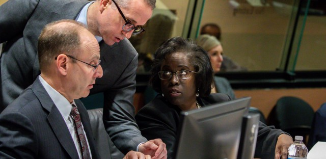 Prosecutors Ron Safer, from left, Brian Watson and Patricia Brown Holmes confer during the trial of Chicago Police Officer Thomas Gaffney, former Detective David March and ex-Officer Joseph Walsh at Leighton Criminal Court Building in Chicago on Tuesday, Dec. 4, 2018 in Chicago. Prosecutors in the trial of the three Chicago police officers charged with lying about the shooting of black teenager Laquan McDonald have rested their case. The move Tuesday came after a witness read emails that prosecutors contend suggest the officers' superiors were intent on protecting the white police officer who fired the fatal shots.