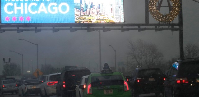 Heavy traffic on an expressway near O'Hare International Airport in Chicago on Sunday, when hundreds of flights were canceled due to a powerful storm.