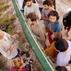 Refugees, right, gather on one side of a fence to talk with international journalists about their journey that brought them to the Island of Nauru on Sept. 19, 2001.
