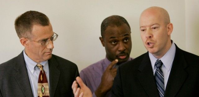 Craig Futterman, right, a University of Chicago law professor, with other members of a police watchdog group, addresses media, Thursday, April 5, 2007, in Chicago where he said research shows the Chicago police department does not police itself. Futterman and watchdog group members, Gerald Frazier, center, of Citizens Alert, and Locke Bowman, left, legal director of the MacArthur Justice Center, said little has been done to stop abuse by officers and pushed for an independent review agency to investigate allegations of police misconduct.
