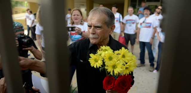 Puerto Rican nationalist Oscar Lopez Rivera greets well wishers as he is released from home confinement after 36 years in federal custody, in San Juan, Puerto Rico, Wednesday, May 17, 2017. Lopez was considered a top leader of Puerto Rican militant group that said it was responsible for more than 100 bombings in several U.S. cities and Puerto Rico during the 1970s and early 1980s.