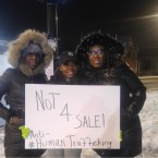 Kisha Roberts-Tabb, right, organizer of a walk against sex trafficking in Roseland, stands with volunteers at the corner of 119th Street and Michigan Avenue on Friday night.
