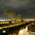 Smoke rises from the Trade Ministry in Baghdad March 20, 2003 after it was hit by a missile during US-led forces attacks. In 2007, four years into the Iraq war, President Bush stared down a Congress in revolt. He bucked public opinion by sending some 30,000 more U.S. soldiers to Baghdad. (AP Photo/Jerome Delay)