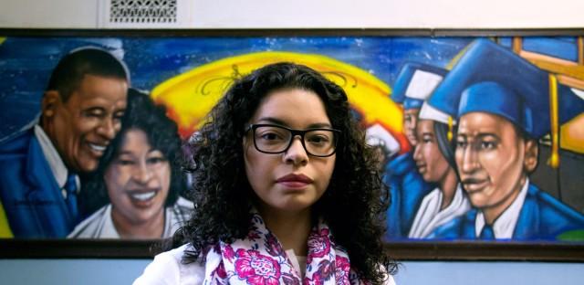 Fatima Salgado is a teacher's aide at Castellanos Elementary School in Little Village. Castellanos has murals throughout the building.