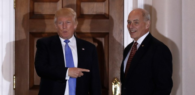 President-elect Donald Trump talks to media as he stands with retired Marine Gen. John Kelly, right, at the Trump National Golf Club Bedminster clubhouse Sunday, Nov. 20, 2016, in Bedminster, N.J..