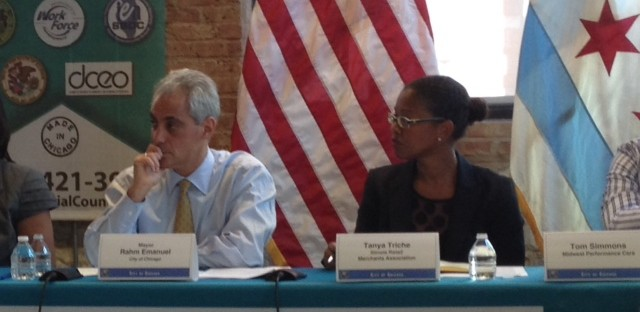 Chicago Mayor Rahm Emanuel speaks with small business owners at a budget roundtable on Wednesday. Emanuel is pushing ahead with a plan to phase-out health care subsidies for retired city workers, despite an ongoing federal lawsuit.
