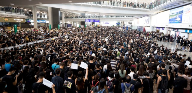 Protesters demonstrate at the airport in Hong Kong, Monday, Aug. 12, 2019. Several thousand people gathered on Monday for a fourth day of protest against a proposed extradition law at Hong Kong's busy international airport.