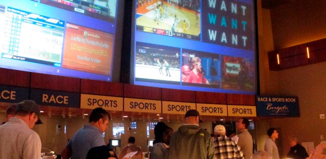Gamblers line up in Atlantic City, N.J. to place bets on the 2019 NCAA men's college basketball tournament — the first March Madness since legal gambling expanded last year in the U.S. Illinois lawmakers are mulling a plan to raise $200 million for the state next year by letting residents bet on their favorite sports teams.