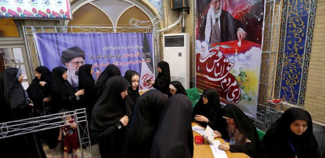 Iranian women cast their ballots for the presidential elections at a polling station at the Lorzadeh mosque in southern Tehran on Friday.
