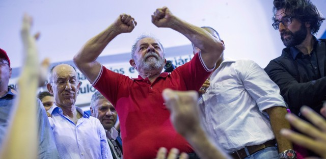Brazilian prosecutors are seeking the arrest of former President Luiz Inacio Lula da Silva, shown here during a during a rally on March 4 in Sao Paulo. He is accused of corruption and embezzlement.