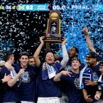 Villanova players celebrate with the trophy after beating Michigan 79-62 in the championship game of the Final Four NCAA college basketball tournament, Monday, April 2, 2018, in San Antonio.